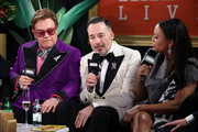 (L-R) Bernie Taupin, Elton John and David Furnish speak on stage at IMDb LIVE Presented By M&M'S At The Elton John AIDS Foundation Academy Awards Viewing Party on February 09, 2020 in Los Angeles, California.