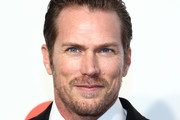 Jason Lewis walks the red carpet at the Elton John AIDS Foundation Academy Awards Viewing Party on February 09, 2020 in Los Angeles, California.