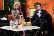 Aisha Tyler and Dave Karger speak on stage at IMDb LIVE Presented By M&M'S At The Elton John AIDS Foundation Academy Awards Viewing Party on February 09, 2020 in Los Angeles, California.