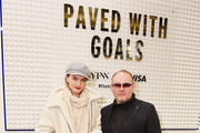 Vlada Roslyakova and Vital Agibalow pose at the Visa retail shop during NYFW: The Shows at Spring Studios on February 08, 2020 in New York City.