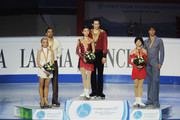 The Silver medalist  Aliona Savchenko and Robin Szolkowy of Germany, the Gold medalist Qing Pang and Jian Tong of China and the Bronze medalist Yuko Kavaguti and Alexander Smirnov of Russia pose on the Podium during the Pairs Free Skating at the 2010 ISU World Figure Skating Championships  on March 24, 2010 in Turin, Italy.