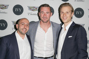 (L-R) IVY Founder Beri Meric, actor Barry Sloane and IVY founder Philipp Triebel attend the IVY Los Angeles innovator dinner presented by Cadillac and IVY at A.O.C on April 15, 2015 in Los Angeles, California.