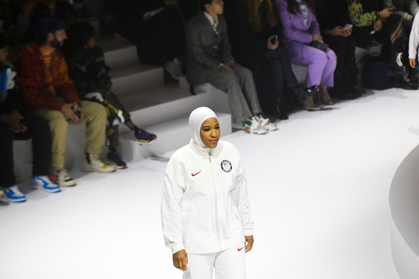 Nike Unveils 2020 Tokyo Olympic Collection [white,fashion,human,fun,recreation,event,competition event,fashion design,crowd,ibtihaj muhammad,runway,us,new york city,the shed,nike unveils 2020 tokyo olympic collection,sabre,tokyo olympic,olympic,collection fashion show,gianna maria-onore bryant,new york,stock photography,getty images,livingly media,photograph,image,royalty-free]