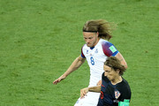 Luka Modric of Croatia is challenged by Birkir Bjarnason of Iceland during the 2018 FIFA World Cup Russia group D match between Iceland and Croatia at Rostov Arena on June 26, 2018 in Rostov-on-Don, Russia.