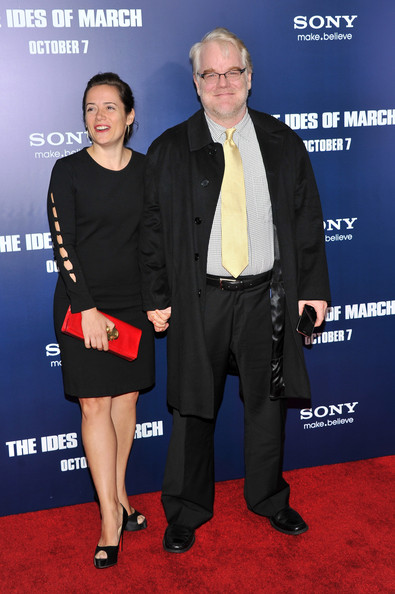 """Mimi O&squot;Donnell and actor Philip Seymour Hoffman attend the premiere of """"The Ides of March"""" at the Ziegfeld Theater on October 5, 2011 in New York City."""