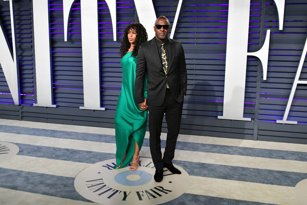 2019 Vanity Fair Oscar Party Hosted By Radhika Jones - Arrivals [fashion,snapshot,purple,formal wear,fashion design,photography,suit,electric blue,style,radhika jones - arrivals,radhika jones,sabrina dhowre,idris elba,l-r,california,beverly hills,wallis annenberg center for the performing arts,oscar party,vanity fair]