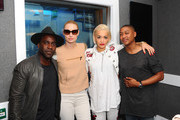 Iggy Azalea and Rita Ora pose with KISS FM's Melvin O'Doom and Ricky Haywood Williams at Kiss FM Studio's on September 18, 2014 in London, England. Rita & Iggy's interview will be broadcasted on KISS Breakfast 6am - 9am on 19th September 2014.