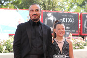 Francesco Di Leva (L) and a guest walk the red carpet ahead of the 'Il Sindaco Del Rione Sanita' (The Mayor Of Rione Sanita) screening during the 76th Venice Film Festival at Sala Grande on August 30, 2019 in Venice, Italy.