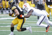 IOWA CITY, IOWA- OCTOBER 07:  Wide receiver Nick Easley #84 of the Iowa Hawkeyes rushes up field during the second quarter past defensive back Tony Adams #6 of the Illinois Fighting Illini on October 7, 2017 at Kinnick Stadium in Iowa City, Iowa.