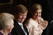 Queen Beatrix of the Netherlands (L) passes the Act of Abdication to her son Prince Willem-Alexander of the Netherlands to sign as his wife Princess Maxima of the Netherlands (R) looks on during the abdication ceremony in the Moseszaal at the Royal Palace on April 30, 2013 in Amsterdam. Queen Beatrix of the Netherlands is abdicating the throne after a 33 year reign and hands the throne to her son Prince Willem-Alexander who will be sworn in later at the Nieuwe Kerk ahead of a joint session of parliament.