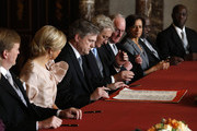 Chairmen of the Senate and the House and other ministers sign the Act of Abdication after Queen Beatrix of the Netherlands, Prince Willem-Alexander of the Netherlands (L) and wife Princess Maxima of the Netherlands (2nd-L) during the abdication ceremony in the Moseszaal at the Royal Palace on April 30, 2013 in Amsterdam. Queen Beatrix of the Netherlands is abdicating the throne after a 33 year reign and hands the throne to her son Prince Willem-Alexander who will be sworn in later at the Nieuwe Kerk ahead of a joint session of parliament.