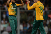 Imran Tahir of South Africa celebrates with captain Faf du Plessis after dismissing Ajinkya Rahane of India during the ICC Twenty20 World Cup warm up match between India and South Africa at Wankhede Stadium on March 12, 2016 in Mumbai, India.