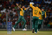 Imran Tahir of South Africa celebrates dismissing Ajinkya Rahane of India during the ICC Twenty20 World Cup warm up match between India and South Africa at Wankhede Stadium on March 12, 2016 in Mumbai, India.