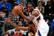DeMarre Carroll #5 of the Atlanta Hawks battles for a rebound against Paul George #24 of the Indiana Pacers at Philips Arena on January 8, 2014 in Atlanta, Georgia.  NOTE TO USER: User expressly acknowledges and agrees that, by downloading and or using this photograph, User is consenting to the terms and conditions of the Getty Images License Agreement.