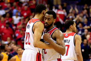 Otto Porter #22 and John Wall #2 of the Washington Wizards confer in the final minutes of their loss against the Indiana Pacers during Game Six of the Eastern Conference Semifinals during the 2014 NBA Playoffs at Verizon Center on May 15, 2014 in Washington, DC. NOTE TO USER: User expressly acknowledges and agrees that, by downloading and or using this photograph, User is consenting to the terms and conditions of the Getty Images License Agreement.