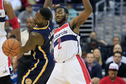 John Wall #2 of the Washington Wizards fouls Donald Sloan #15 of the Indiana Pacers during the first half at Verizon Center on November 5, 2014 in Washington, DC. NOTE TO USER: User expressly acknowledges and agrees that, by downloading and or using this photograph, User is consenting to the terms and conditions of the Getty Images License Agreement