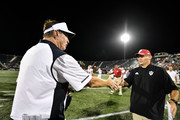 Head coach Butch Davis of the FIU Golden Panthers and Head coach Tom Allen of the Indiana Hoosiers shake hands after the game between the FIU Golden Panthers and the Indiana Hoosiers at Ricardo Silva Stadium on September 1, 2018 in Miami, Florida.