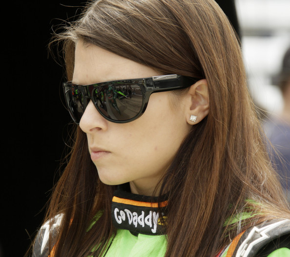 Danica Patrick of Andretti Autosport watches on as her crew readies her car