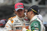 Dan Wheldon of England, driver of the #98 William Rast-Curb/Big Machine Dallara Honda, is congratulated by Tony Kanaan of Brazil, driver of the #82 Lotus KV Racing Technologies Dallara Honda, after winning the IZOD IndyCar Series Indianapolis 500 Mile Race at Indianapolis Motor Speedway on May 29, 2011 in Indianapolis, Indiana.