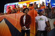 Professional golfers Webb Simpson, left, and Bubba Watson watch a game between the Denver Broncos and the Indianapolis Colts from the sideline near the tunnel at Sports Authority Field at Mile High on September 7, 2014 in Denver, Colorado.