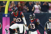 Kevin Johnson #30 of the Houston Texans and Braxton Miller #13 celebrate after a defensive stop against the Indianapolis Colts in the first half at NRG Stadium on October 16, 2016 in Houston, Texas.