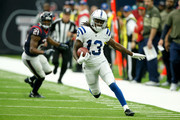 T.Y. Hilton #13 of the Indianapolis Colts runs the ball after a reception defended by Marcus Gilchrist #21 of the Houston Texans in the third quarter at NRG Stadium on November 5, 2017 in Houston, Texas.