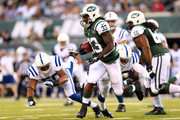 Running back Chris Ivory #33 of the New York Jets runs the ball in the first quarter against the Indianapolis Colts during a preseason game at MetLife Stadium on August 7, 2014 in East Rutherford, New Jersey.