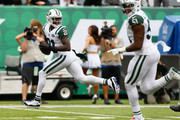 Cornerback Morris Claiborne #21 of the New York Jets runs the ball 17 yards for a touchdown after making an interception against the Indianapolis Colts  in the first quarter at MetLife Stadium on October 14, 2018 in East Rutherford, New Jersey.