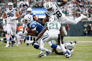 Wide receiver Marcus Johnson #16 of the Indianapolis Colts is tackled by cornerback Morris Claiborne #21 and inside linebacker Darron Lee #58 of the New York Jets during the first quarter at MetLife Stadium on October 14, 2018 in East Rutherford, New Jersey.