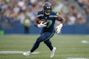 Running back Mike Davis #27 of the Seattle Seahawks rushes against the Indianapolis Colts at CenturyLink Field on August 9, 2018 in Seattle, Washington.