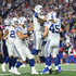 Andrew Luck Photos - Andrew Luck #12 celebrates with Erik Swoope #86 of the Indianapolis Colts after scoring a touchdown during the fourth quarter against the New England Patriots at Gillette Stadium on October 4, 2018 in Foxborough, Massachusetts. - Indianapolis Colts vs. New England Patriots