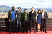 """From left : Actors Omar Sy, Irrfan Khan, director Ron Howard, actor Tom Hanks, actress Felicity Jones and author Dan Brown pose during a photocall on the eve of the World Premiere of the movie """"Inferno"""" on October 7, 2016 in Florence.  / AFP / Giusi Sproviero"""