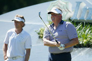 Colin Montgomerie of Scotland watches his tee shot on the 14th hole as Bernhard Langer of Germany looks on during the final round of the Insperity Invitational at the Tournament Course at the Woodlands Country Club on May 4, 2014 in The Woodlands, Texas.