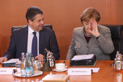 German Chancellor Angela Merkel (CDU) (R) and Vice Chancellor and Foreign Minister Sigmar Gabriel (SPD) arrive for the weekly German federal Cabinet meeting on December 13, 2017 in Berlin, Germany. High on the agenda were topics pertaining to immigration.