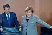 German Chancellor Angela Merkel and German Vice Chancellor and Foreign Minister Sigmar Gabriel take their seats at the beginning of the weekly cabinet meeting in Berlin on December 13, 2017.   / AFP PHOTO / TOBIAS SCHWARZ