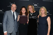 (L to R) Executive Producer Michael Lumpkin, producer Liz Garbus, producer Geralyn Dreyfous and director Rory Kennedy attend the International Documentary Association's 2013 IDA Documentary Awards at Directors Guild Of America on December 6, 2013 in Los Angeles, California.