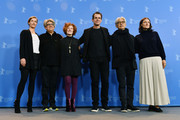 Jury Members Cecile de France, Chema Prado, Stephanie Zacharek, Jury President Tom Tykwer, jury members Ryuichi Sakamoto and Adele Romanski pose at the International Jury photo call during the 68th Berlinale International Film Festival Berlin at Grand Hyatt Hotel on February 15, 2018 in Berlin, Germany.