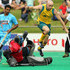 Glenn Turner Photos - Glenn Turner of Australia jumps over PR Sreejesh of India during the match between Australia and India on day three of the International Superseries at Perth Hockey Stadium on October 22, 2011 in Perth, Australia. - International Superseries - Day 3