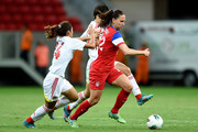 Lauren Holiday (R) of the USA struggles for the ball with Tang Jiali (L) and Ren Guixin of China during a match between USA and China as part of International Women's Football Tournament of Brasilia at Mane Garrincha Stadium on December 10, 2014 in Brasilia, Brazil.