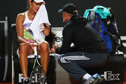 Ana Ivanovic of Serbia talks to her coach during her match against Anastasia Pavlyuchenkova of Russia during day two of The Internazionali BNL d'Italia 2016 on May 09, 2016 in Rome, Italy.