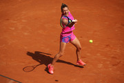Simona Halep of Romania plays a forehand in her quarter-final match against Yulia Putintseva of Kazakhstan during day six of the Internazionali BNL d'Italia at Foro Italico on September 19, 2020 in Rome, Italy.