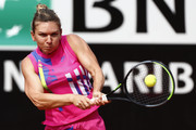 Simona Halep of Romania plays a backhand in her quarter-final match against Yulia Putintseva of Kazakhstan during day six of the Internazionali BNL d'Italia at Foro Italico on September 19, 2020 in Rome, Italy.