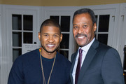 Singer Usher and Morehouse College President Dr. John Silvanus Wilson, Jr. attend an intimate gathering in honor of Norman Lear at Morehouse College on November 30, 2015 in Atlanta, Georgia.