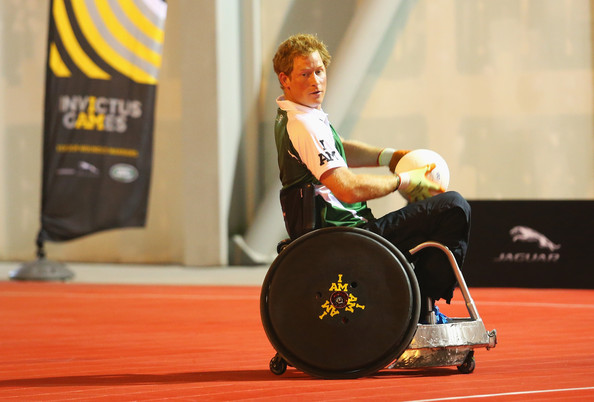 (STRICTLY EMBARGOED FOR PUBLICATION UNTIL 7PM BST) Prince Harry carries the ball during a training session for the Jaguar Land Rover Exhibition Wheelchair Rugby Match on day 2 of the Invictus Games, presented by Jaguar Land Rover at Queen Elizabeth Olympic Park on September 12, 2014 in London, England.