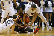A.J. English #5 of the Iona Gaels fights off Justin Robinson #12 of the Monmouth Hawks but has the ball stolen by the Hawks Austin Tilghman #23 during the second half of a college basketball game at the MAC on February 19, 2016 in West Long Branch, New Jersey. Iona defeated Monmouth 83-67.