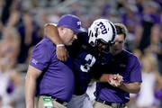 Shawn Robinson #3 of the TCU Horned Frogs leaves the game after being injured in the fourth quarter against the Iowa State Cyclones at Amon G. Carter Stadium on September 29, 2018 in Fort Worth, Texas.