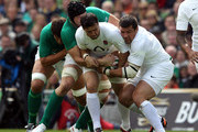Ben Foden and Hendre Fourie (R) of England hold onto the ball during the international match between Ireland and England at the Aviva Stadium on August 27, 2011 in Dublin, Ireland,