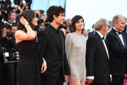 """(L-R) Marion Cotillard, Louis Garrel, Charlotte Gainsbourg, Hippolyte Girardot and director Arnaud Desplechin attend the """"Ismael's Ghosts (Les Fantomes d'Ismael)"""" screening and Opening Gala during the 70th annual Cannes Film Festival at Palais des Festivals on May 17, 2017 in Cannes, France."""