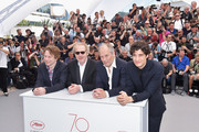 """(L-R) Actor Mathieu Amalric, director Arnaud Desplechin, actor Hippolyte Girardot and actor Louis Garre attend the """"Ismael's Ghosts (Les Fantomes d'Ismael)"""" photocall during the 70th annual Cannes Film Festival at Palais des Festivals on May 17, 2017 in Cannes, France."""