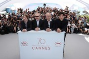 (FromL) French actor Mathieu Amalric, French director Arnaud Desplechin, French actor Hippolyte Girardot and French actor Louis Garrel pose on May 17, 2017 during photocall for the film 'Ismael's Ghosts' (Les Fantomes d'Ismael) ahead of the opening ceremony of the 70th edition of the Cannes Film Festival in Cannes, southern France.  / AFP PHOTO / Valery HACHE